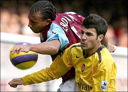 Cesc Fabregas is challenged by Anton Ferdinand
