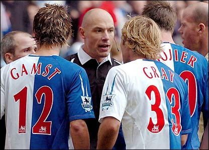 Blackburn's players protest to referee Howard Webb