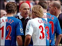 Blackburn's players confront referee Howard Webb (centre)