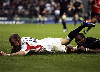 Jamie Noon scores a try for England