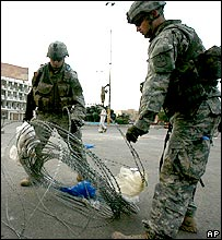 US soldiers laying barbed wire in Baghdad
