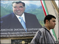 A man walks past a poster of Emomali Rakhmonov  in Dushanbe, 1st Nov