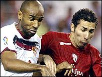 Sevilla goalscorer Frederic Kanoute (left) in action against Osasuna