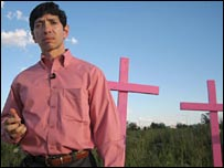 Oscar Maynez, former forensic scientist, next to pink crosses