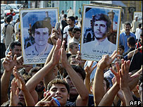Shia Iraqis in Baghdad celebrate the guilty verdict against Saddam Hussein