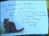 Card left on floral tribute