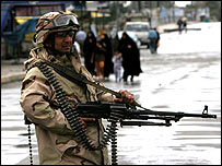 An Iraqi soldier enforcing a curfew in Sadr City, Baghdad.