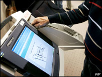 A man casts an early vote on an electronic machine in Salt Lake City