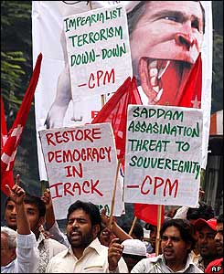 Activists of the Communist Party of India (Marxist) shout anti-US slogans in Hyderabad, India.