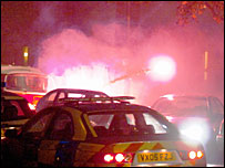 Officers bombarded by fireworks - picture courtesy of Gloucestershire Echo