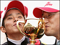 Jockey Yasunari Iwata and trainer Katsuhiko Sumii after their Melbourne Cup win