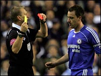 Referee Graham Poll sends off Chelsea captain John Terry