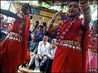 Zinedine Zidane watching dancers in a Bangladeshi village