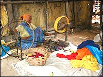 A woman weaver in a Delhi slum