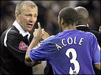 Referee Graham Poll (left) and Chelsea defender Ashley Cole exchange words during the Blues' loss at Spurs on Sunday