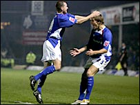 Colin Larkin (left) and Kevan Hurst celebrate Chesterfield's early goal against Charlton