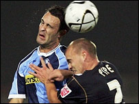 Wycombe's Stefan Oakes (left) tussles with County's David Pipe