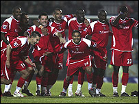 Charlton players celebrate after their shoot-out victory