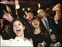 Guests cheer as early election results are announced at the Democratic Congressional Campaign Committee election night party in Washington