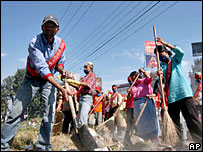 Nepal's Maoist rebels cadres sweep a street during their clean-up campaign in Kathmandu.