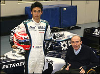 Kazuki Nakajima poses with team owner Sir Frank Williams