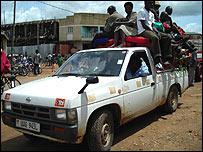 Truck carrying goods and people