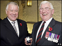 Maj Maurice Barlow receives his badge from Armed Forces Minister Adam Ingram