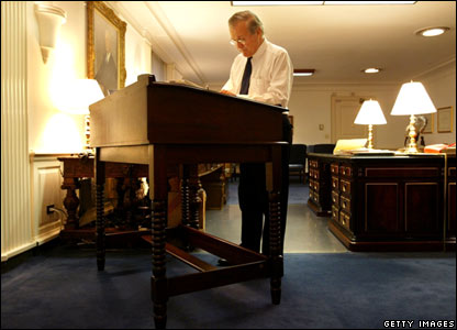 US Defence Secretary Donald Rumsfeld stands in his office (20 November 2003)