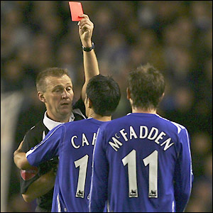 Graham Poll brandishes the red card in James McFadden's direction