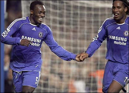 Essien and Didier Drogba celebrate