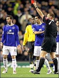 Graham Poll (far right) sends off Everton's James McFadden (far left) as Tim Cahill (centre) looks on