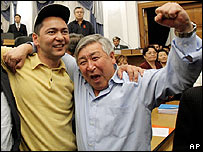Opposition lawmakers celebrate parliament's approval of a new constitution on 8 Wednesday 2006