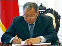 President Kurmanbek Bakiyev signs an amended constitution in Bishkek