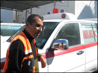 Mohammed Sadawy in front of an ambulance