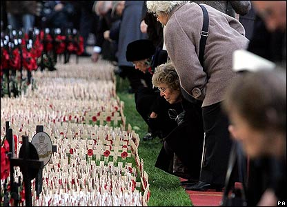 People viewing crosses at the Field of Remembrance opening