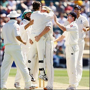 Andrew Flintoff celebrates with Geraint Jones after taking the first wicket for England