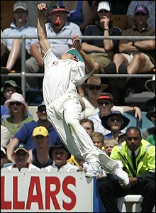 Alastair Cook leaps high in the air but fails to prevent the ball going for four