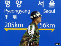 South Korean soldier passes sign at Dorasan railway station, near North-South frontier