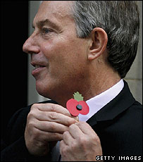 Tony Blair pins on a poppy