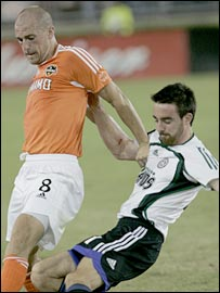Paul Dalglish holds off a Colorado Rapids defender