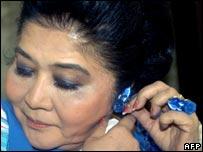 Imelda Marcos trying on a new Imelda earring