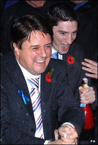 Nick Griffin and Mark Collett celebrate their victory