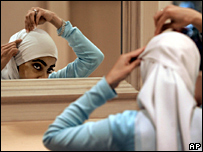 A woman adjust her headscarf