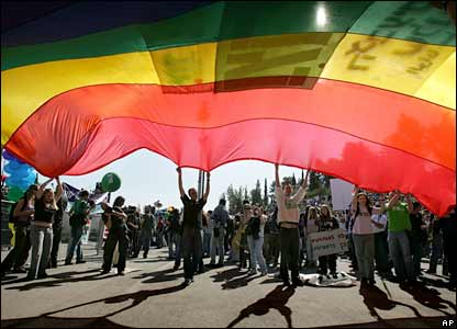 Participants carry a rainbow gay flag during a gay pride happening in Jerusalem