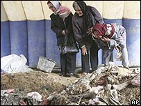 Relatives of victims at a mass grave