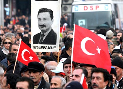 People with posters, one reads: Our hope is Ecevit