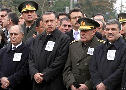 Senior Turkish officials watch the hearse carrying Bulent Ecevit's body