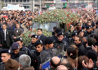 A hearse with flowers carries the casket of Bulent Ecevit