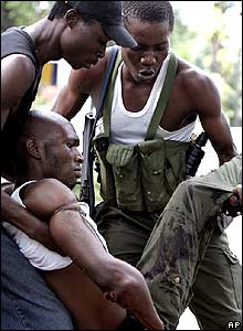 Injured fighter in Kinshasa