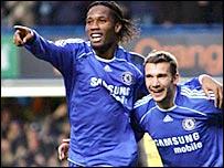 Dider Drogba celebrates with Chelsea team-mate Andriy Shevchenko